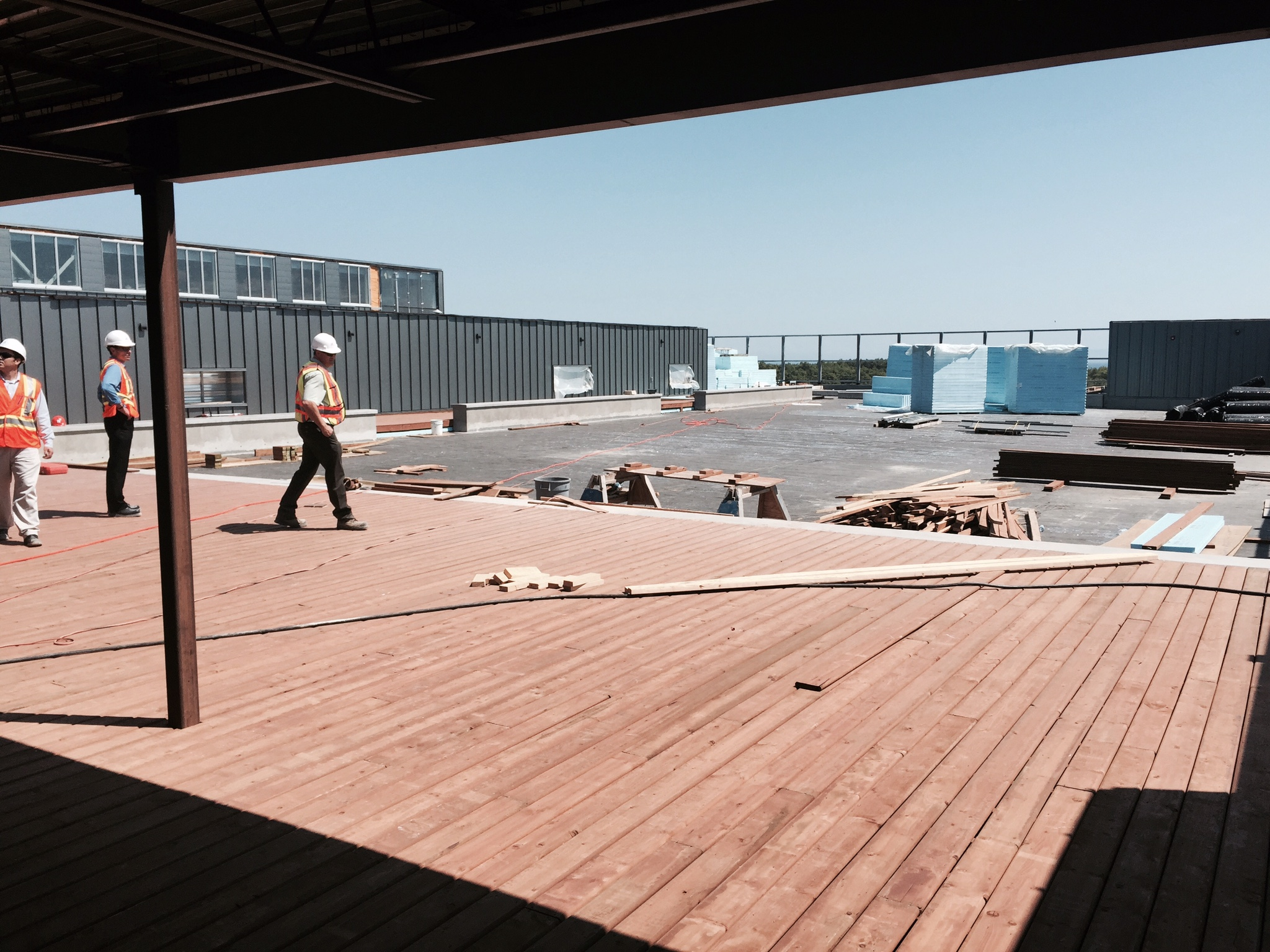 Laying the deck around the rooftop basketball court